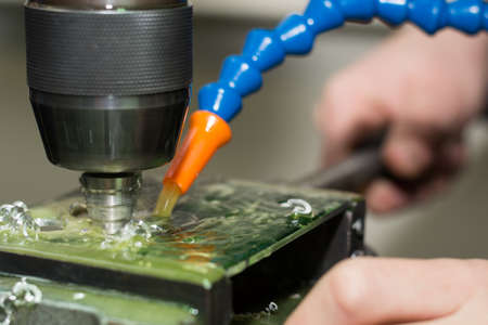 coolant: Drill step drill drills with coolant holes in plastic Stock Photo