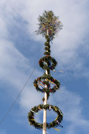 maypole: on festively decorated maypole hang colorful ribbons