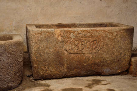 countrified: old granite trough in the basement Stock Photo