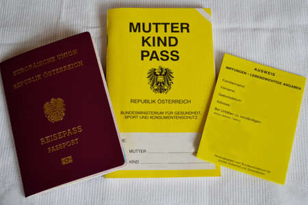 sameness: Passport, vaccination certificate and mother-child pass Stock Photo