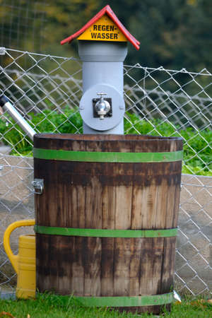 hydrological: Rainwater connection with wooden barrel in the garden