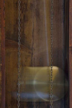 Pendulum of an old grandfather clock
