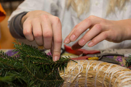 advent wreath: Person binds Advent wreath - close-up Stock Photo