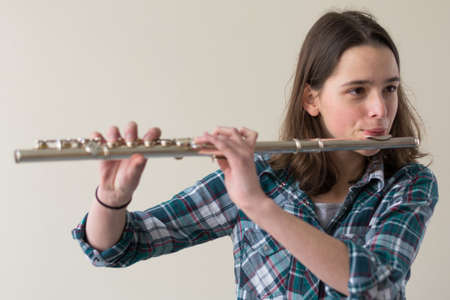 musically: Teenagers playing flute - Portrait and Copy Space