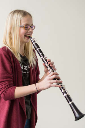 vivre: Girl playing clarinet and starts laughing