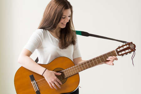 musically: happy teenagers playing guitar - Copy Space