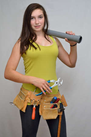 apprenticeship employee: Youth as an apprentice in pose with tool