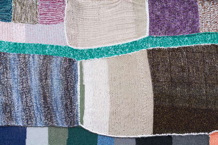 patchwork quilt: colorful knitted parts connected to a patchwork quilt