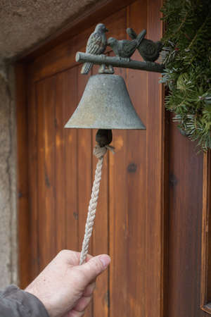 knell: Person ringing at Old doorbell - Closeup