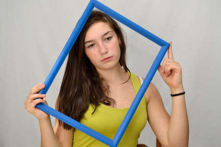 fair skinned: Youth looks sadly through a picture frame Stock Photo