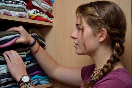 teeny: Teenager looking in the closet after matching clothes