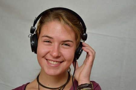 teeny: Teenagers listening with headphones enthusiastic music - released and copy-space