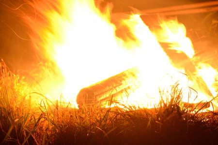 menacing: garishly bright campfire menacing
