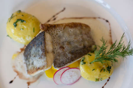 edible fish: delicate edible fish with potatoes and garnished