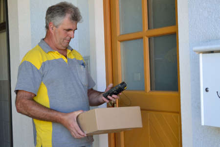 delivers: Postman delivers packet into the house