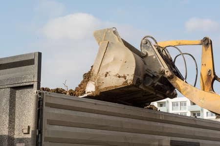 skid loader: Excavation tilts earth of construction loaders