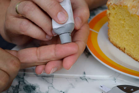 deterministic: Person measures the blood glucose levels - close-up