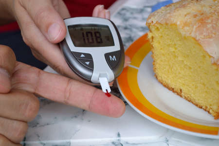 deterministic: In patients blood glucose levels are measured Stock Photo