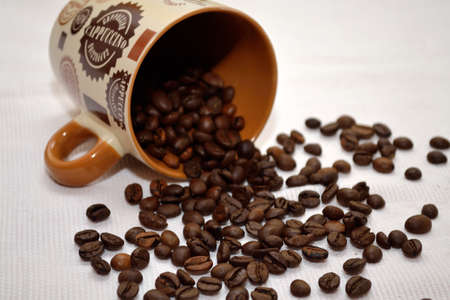 decaffeinated: sown with coffee beans lying brown coffee cup
