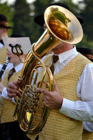 tenor: Musicians in costume plays baritone, a form of Tenor Horns