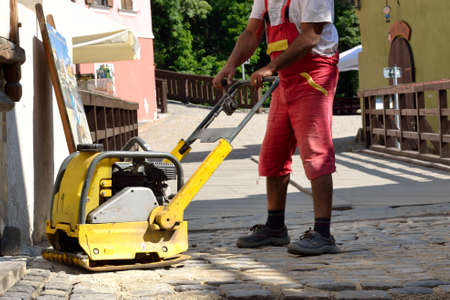 solidified: Paving stones are solidified with vibration plate
