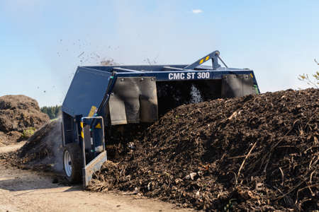 Compost is treated with compost turner and accelerates composting