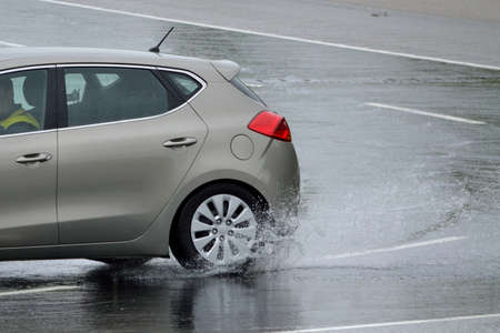 hydroplaning: Car will obtain special driving training to skid - closeup