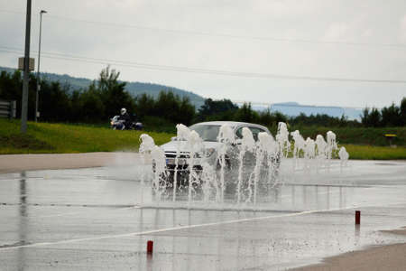 hydroplaning: uto and motorcycle safety course on training grounds Stock Photo