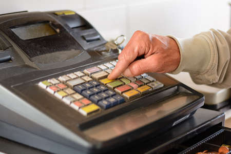 checkout: Person on board old merchant checkout - Close-up