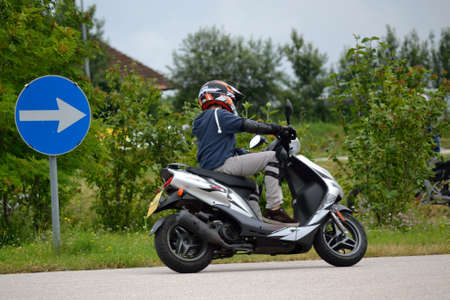 Driving training with moped on practice area