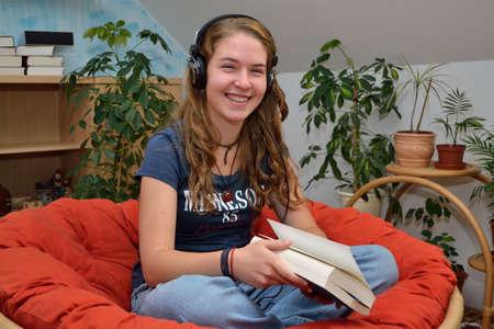 avid: Teenager listens comfortably in room music