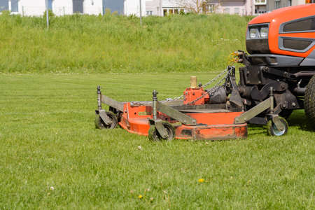 cut grass: Grass is cut with the Rider - Lawn Tractor