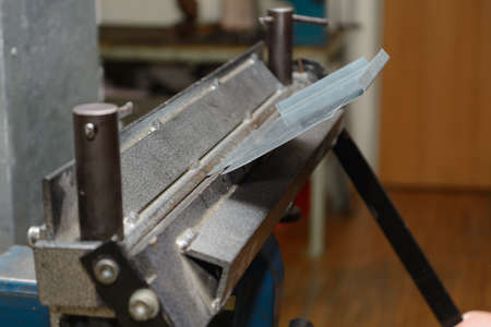 Craftsmen worked with a bending machine sheet Stock Photo - 58918063