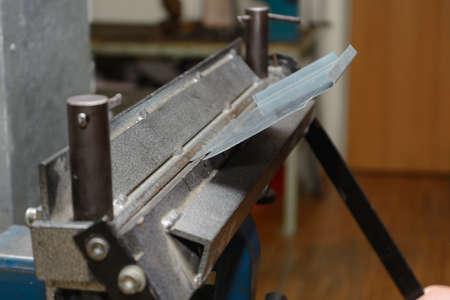 artisanry: Craftsmen worked with a bending machine sheet