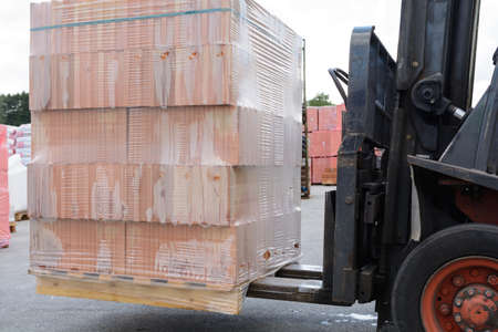 transported: With a forklift pallet brick is transported