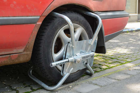 wheel clamp - theft protection or remedy for traffic offenders