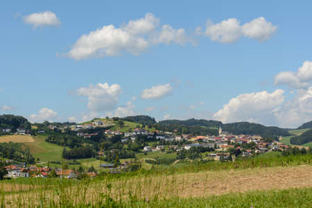 a rural community: romantic idyllic rural community Peilstein situated on a hill - Austria