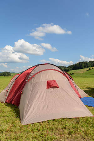 Tense tent in summer in quiet landscape