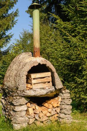 woodfired: Nostalgic stone oven in the open nature - closeup nostalgic oven
