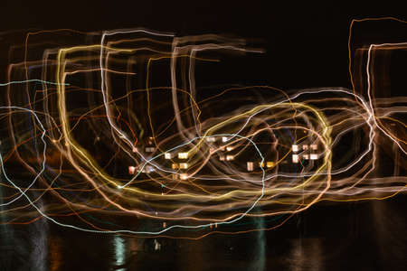 Lightpainting, light trails and reflections at night - long exposure Stock Photo