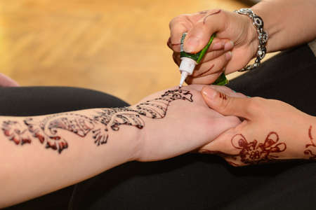 Mehndi Tattoo Designs For Upper Arms : A blue tattoo on an upper arm of woman stock photo picture and