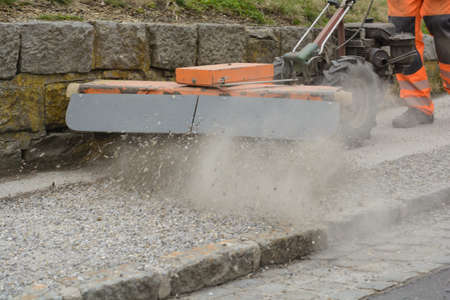 bourgeon: Sweeper cleans bourgeon dough from loose chippings - close-up