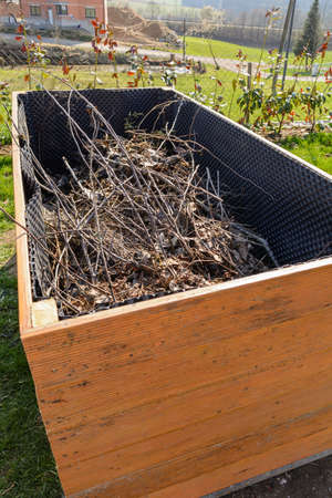 self contained: Self-contained raised bed with a shrub cut as a base