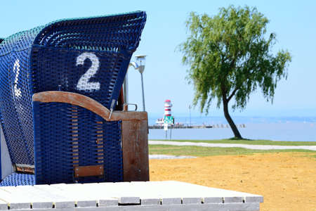 Beach basket with lighthouse in the background of Lake Neusiedl - Austria