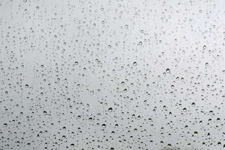 many rain drops on a window glass - background