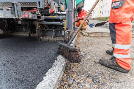 Workers at asphalting works of a sidewalk - close-up Stock fotó - 90083405