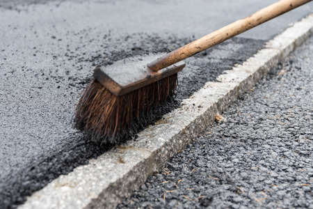 Broom for asphalting works in road construction - close-up