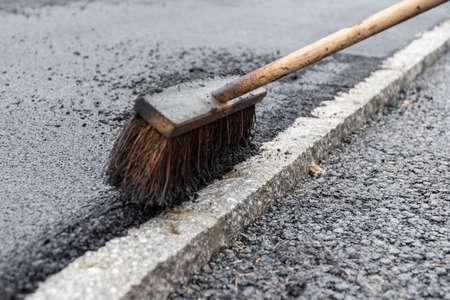 Broom for asphalting works in road construction - close-up Stock fotó - 90083459
