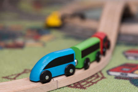 Colorful model train made of environmentally friendly wood - close-up Stock Photo