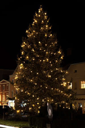 electrically lit Christmas tree on a romantic town square